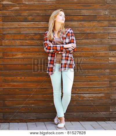 Modern Pretty Hipster Girl In Smart Casual Clothes Posing Against Wooden Background Outdoors