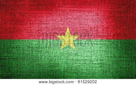 Burkina Faso flag on burlap fabric