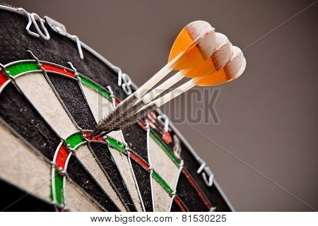Three Darts Hitting Perfect 180 Score On Dart Board