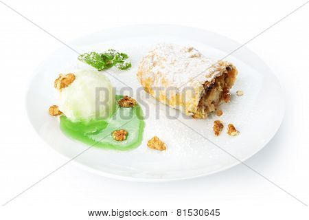 Restaurant Food Isolated - Apple Strudel With Mint Sauce, Ice Cream And Walnuts