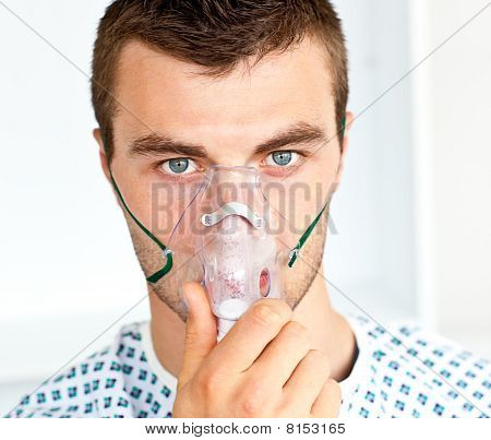 Male Handsome Patient  Wearing A Mask