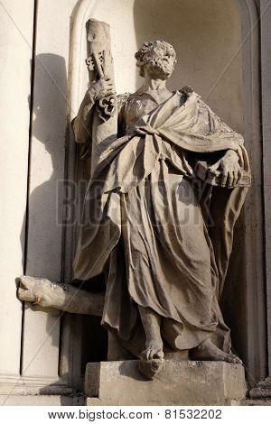 GRAZ, AUSTRIA - JANUARY 10, 2015: Saint Peter the Apostle on the facade of Parish Church of the Holy Blood in Graz, Styria, Austria on January 10, 2015.