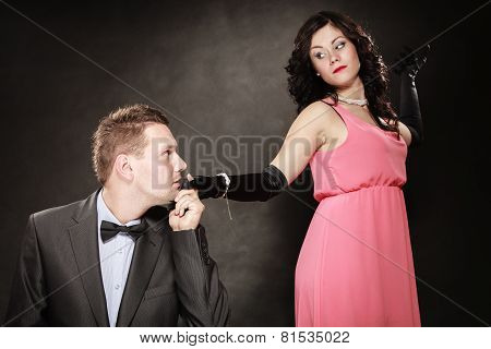 Man In Suit And Woman In Evening Dress.