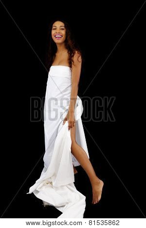 Young Latina Woman Standing Wrapped In White Sheet