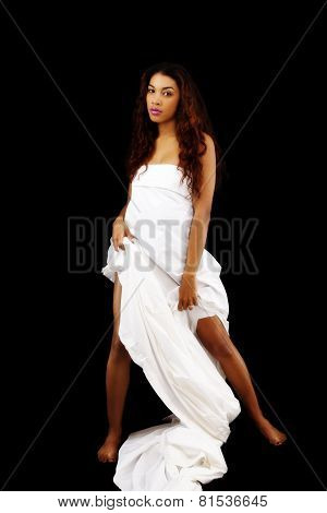 Latina Woman Standing Wrapped In White Sheet