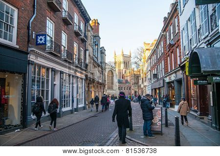 Trinity street with college view and tourists walking by