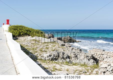 View of the promenade on the eastern shore of the ocean in Isla Mujeres, Mexico. The island is located 8 miles east of Cancun in the Gulf of Mexico.