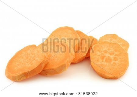 cut sweet potato slices on a white background