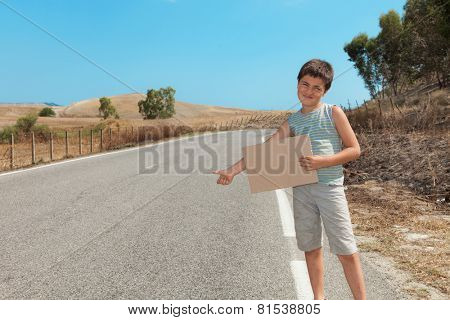 little boy hitchhiking along the street, portrait