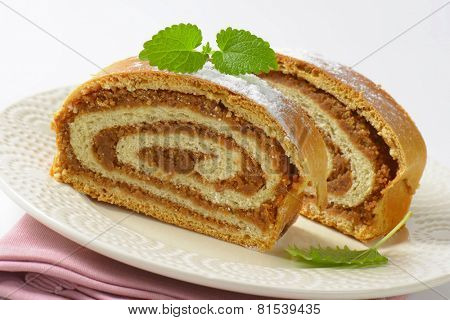 detail of nut strudel on the plate with pink linen