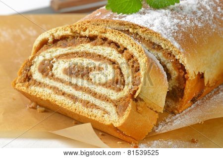 sliced loaf of nut strudel on the baking paper
