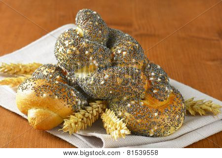 detail of poppy seeds buns with wheat ears