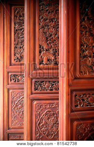 Local Bai style old door in Dali old town. Yunnan, China.