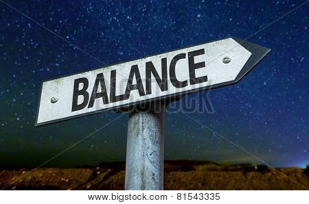 Balance sign with a beautiful night background