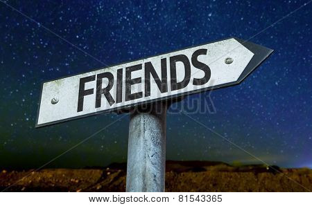 Friends sign with a beautiful night background