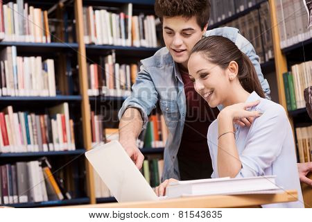 Schoolmates Studying Together At The Library
