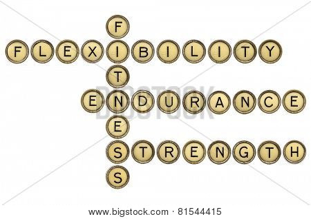 fitness, flexibility, endurance and strength crossword in old round typewriter keys isolated on white