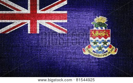 Cayman Islands flag on burlap fabric