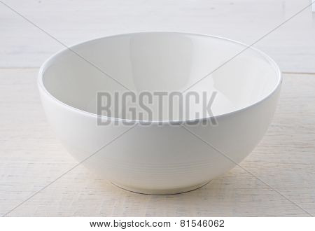 Empty White Bowl On Wooden Table