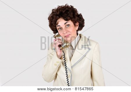 Woman on the retro telephone