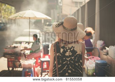 Young Woman Walking In The Street Of Asian Country