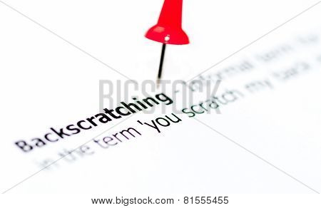 Closeup Shot Over Word Backscratching On Paper