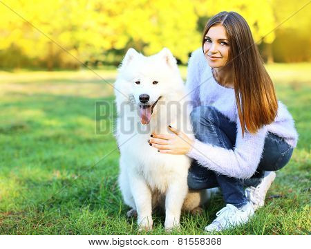 Happy Pretty Woman Owner And Dog Outdoors In The Park