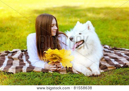 Portrait Happy Pretty Woman And White Samoyed Dog Having Fun Outdoors On The Grass