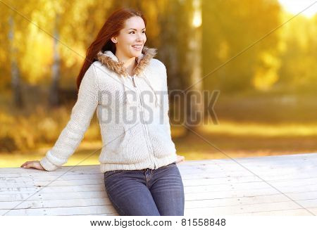 Pretty Smiling Woman Outdoors Enjoying Warm Sunny Autumn Weather