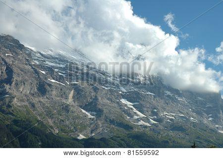 Ridge And Eiger Peak In Clouds Nearby Grindelwald In Switzerland