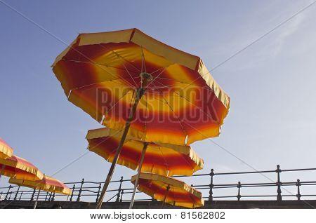 Red And Yellow Beach Umbrellas On Amalfi Beach