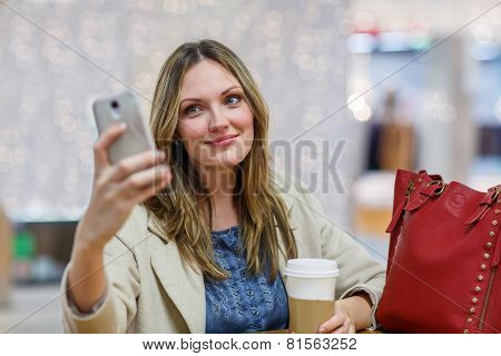 Young Woman  At International Airport, Making Selfie With Mobile