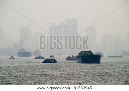 Shanghai Skyline With Boats In Thick Fog