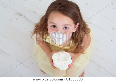 Happy child holding birthday cake