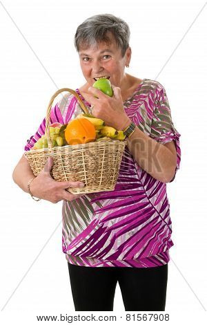 Senior Woman Biting Into An Apple