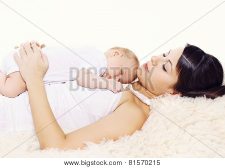 Mother And Baby Sleeping Together