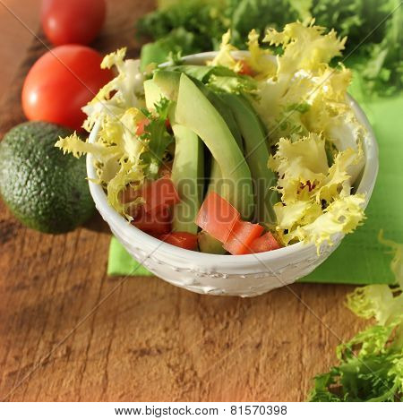salad with avocado,tomatoes, endive