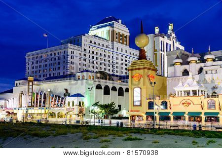 ATLANTIC CITY, NEW JERSEY - SEPTEMBER 8, 2012: Casinos line the Atlantic City boardwalk at dusk.