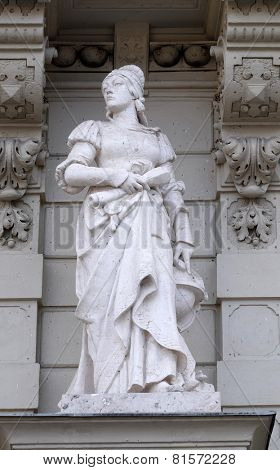 GRAZ, AUSTRIA - JANUARY 10, 2015: Statue of Science, allegorical representation, detail of Rathaus Town Hall, Graz, Styria, Austria on January 10, 2015.