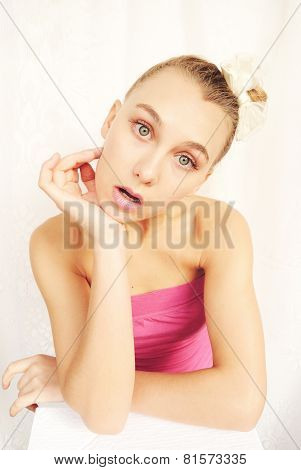 portrait of a girl looking like surprised doll with green eyes and blond girl isolated on white back