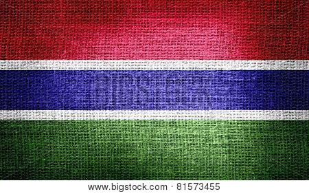 Gambia flag on burlap fabric