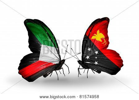 Two Butterflies With Flags On Wings As Symbol Of Relations Kuwait And Papua New Guinea