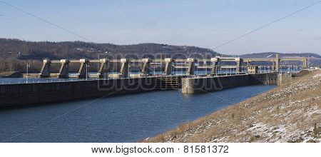 Panorama Photo. Lock and Dam on River with Clear Skies.