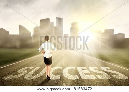 Businesswoman Standing On The Success Way