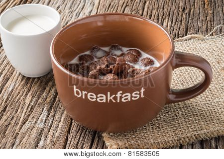 Chocolate Cornflakes On Wooden Background