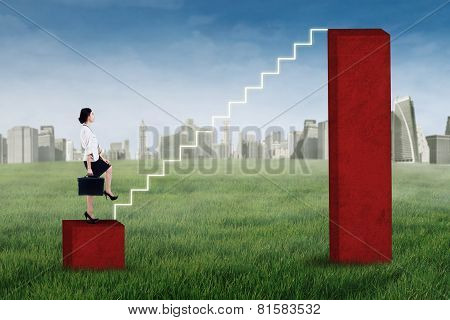 Businesswoman Stepping Up On The Staircase