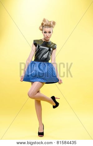 young girl posing standing on one leg