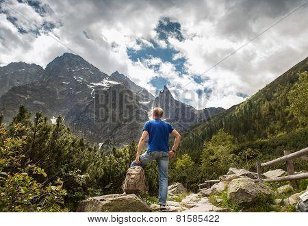 Mountain Traveler Looks On Wild Rocks