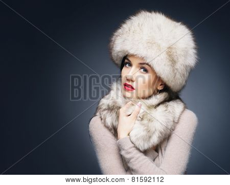 Portrait of a young and beautiful lady in a typical Russian winter clothes