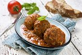 stock photo of meatballs  - meatballs in tomato sauce in a blue plate - JPG